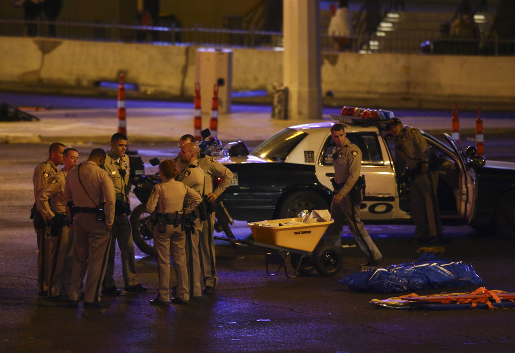 Las Vegas police gather following an active shooter situation that left 50 dead and more than 400 injured on the Las Vegas Strip during the early hours of Monday, Oct. 2, 2017. Chase Stevens Las V ...