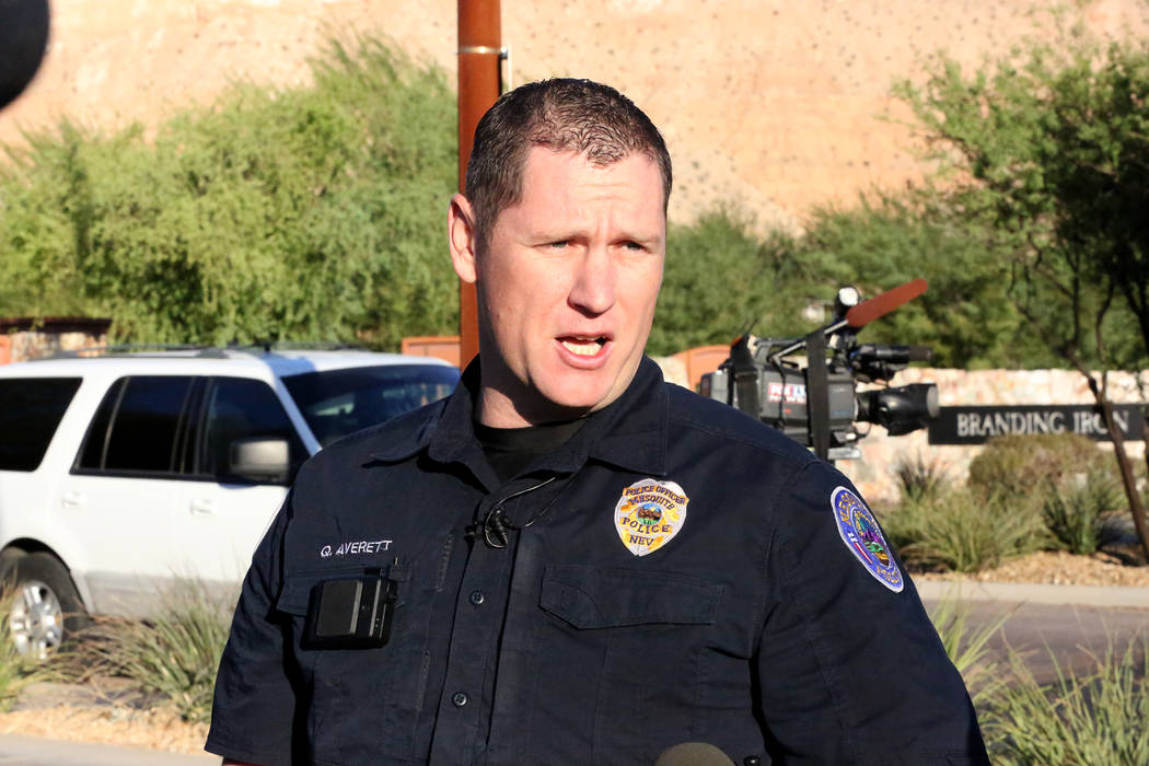 Mesquite Police Department Public Information Officer Quinn Everett speaks with the press a few blocks from the home of Stephen Paddock the man who went on a shooting spree from the Mandalay hotel ...