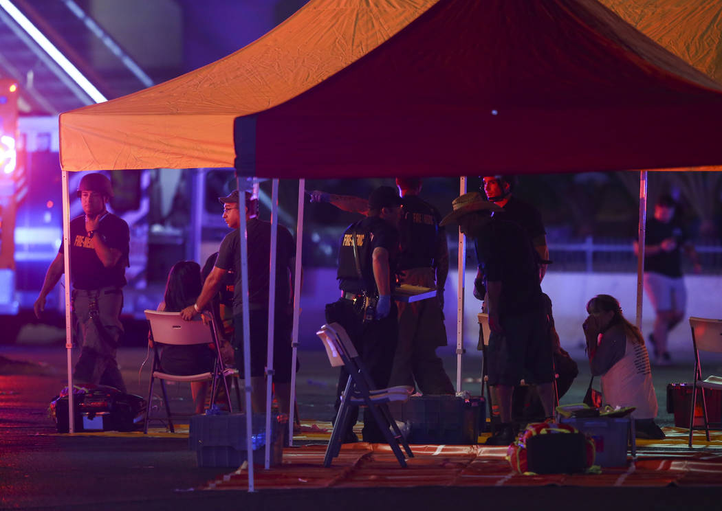 Emergency workers treat the wounded as Las Vegas police respond during an active shooter situation on the Las Vegas Strip in Las Vegas on Sunday, Oct. 1, 2017. Chase Stevens Las Vegas Review-Journ ...