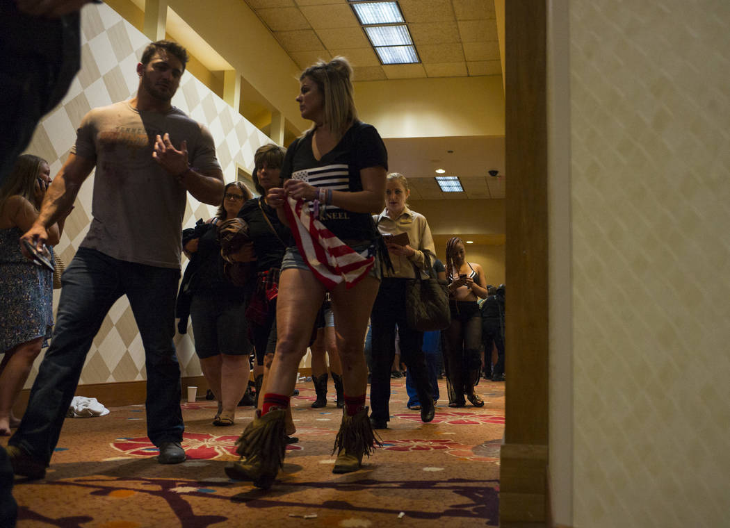 People walk through the Tropicana Las Vegas after being searched during an active shooter situation on the Las Vegas Stirp in Las Vegas on Sunday, Oct. 1, 2017. Chase Stevens Las Vegas Review-Jour ...