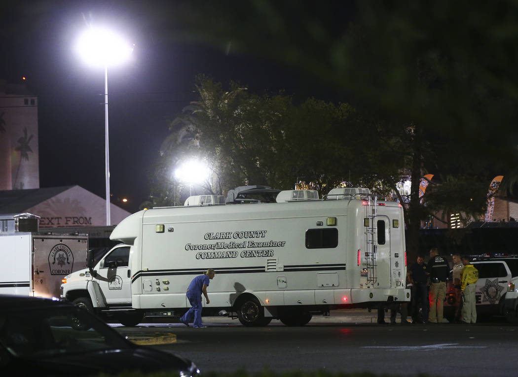 The Clark County Coroner arrives as Las Vegas police investigate following an active shooter situation that left more than 50 dead and 400 injured on the Las Vegas Strip during the early hours of  ...