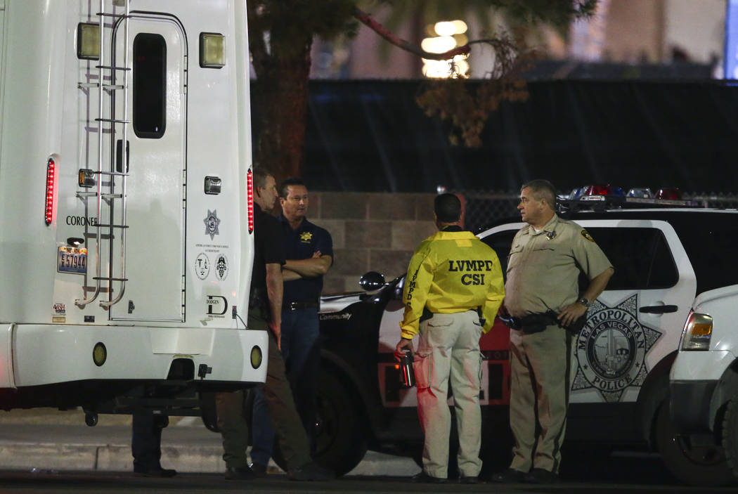 Las Vegas police investigate following an active shooter situation that left more than 50 dead and 400 injured on the Las Vegas Strip during the early hours of Monday, Oct. 2, 2017. Chase Stevens  ...