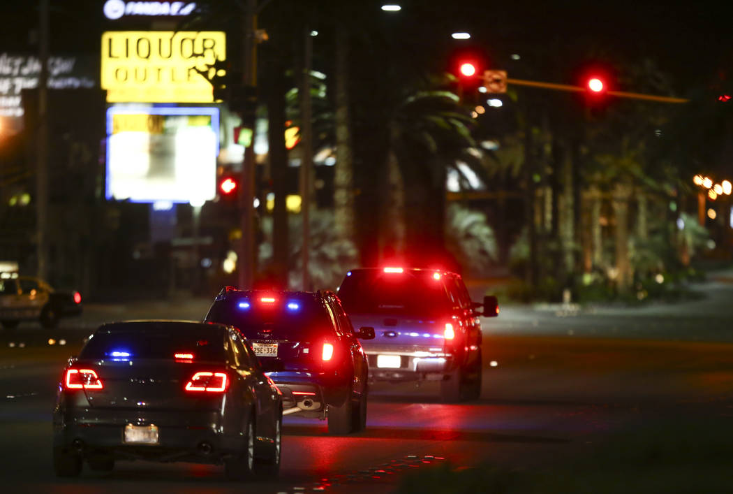 Emergency vehicles head down Las Vegas Boulevard following an active shooter situation that left more than 50 dead and 400 injured on the Las Vegas Strip during the early hours of Monday, Oct. 2,  ...