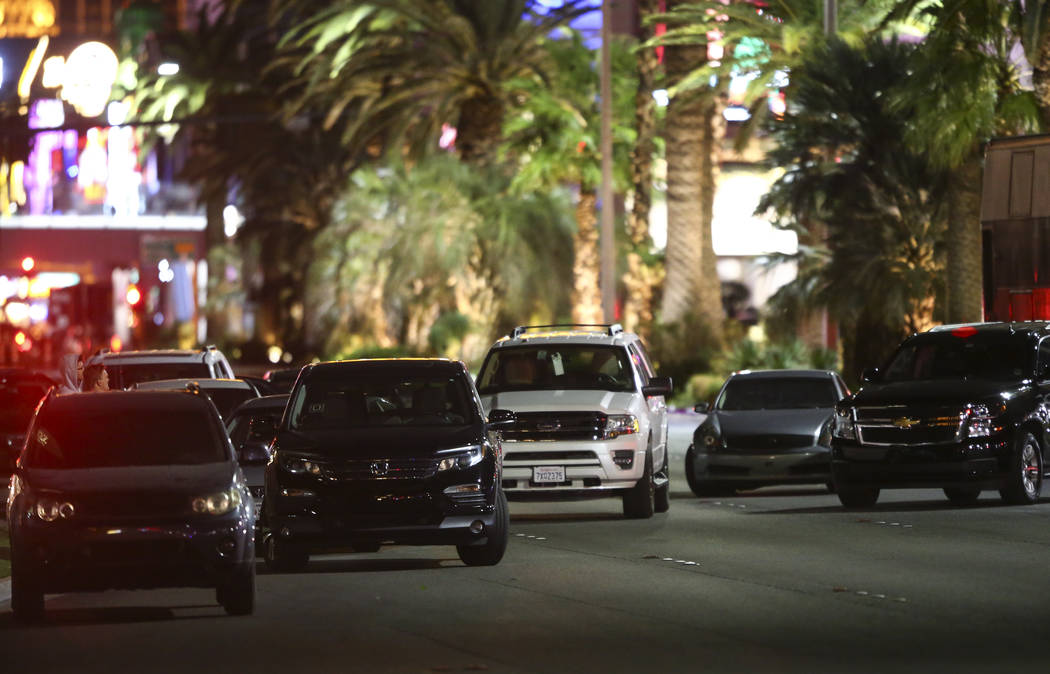 Cars left on Las Vegas Boulevard following an active shooter situation that left more than 50 dead and 400 injured on the Las Vegas Strip during the early hours of Monday, Oct. 2, 2017. Chase Stev ...