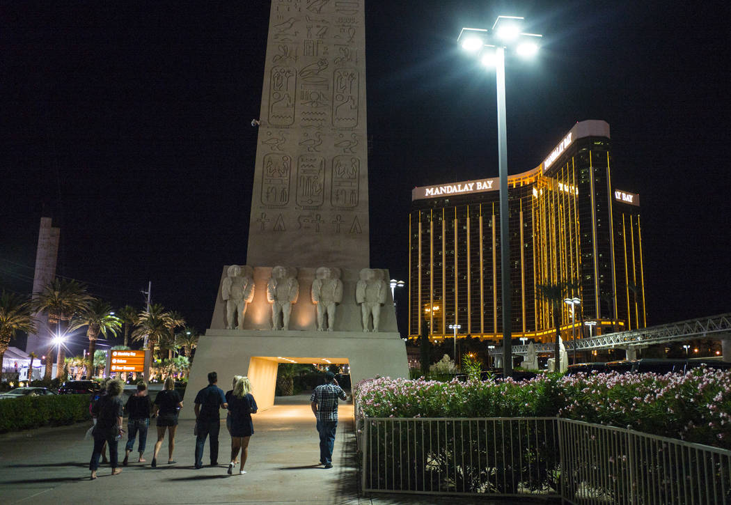 Tourists make their way back to their hotels following an active shooter situationthat left more than 50 dead and 400 injured on the Las Vegas Strip during the early hours of Monday, Oct. 2, 2017. ...