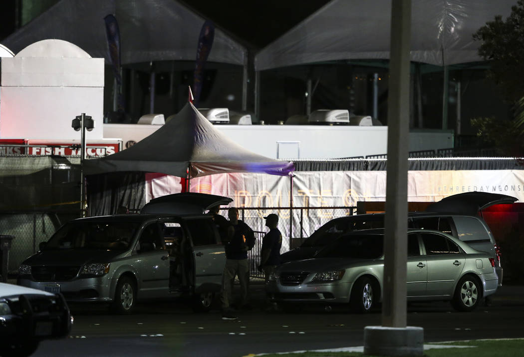Festival grounds for Route 91 rise in the background as Las Vegas police investigate following an active shooter situation that left more than 50 dead and 400 injured on the Las Vegas Strip during ...