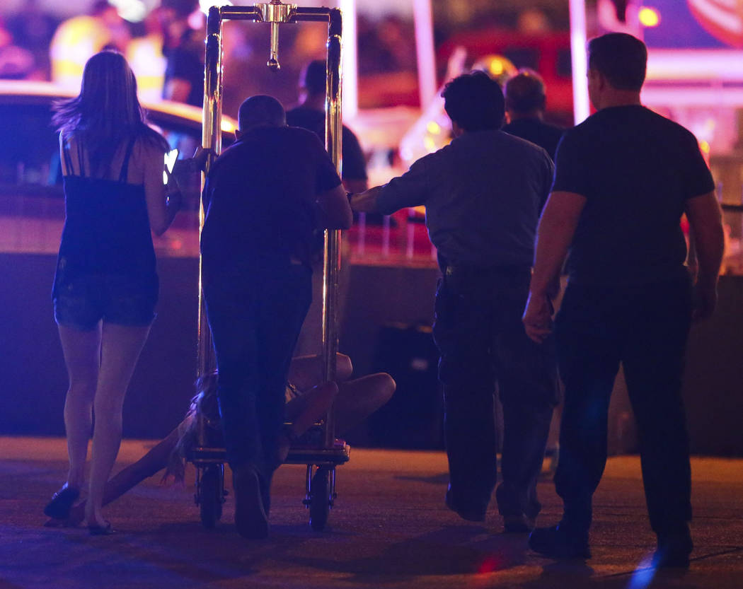 A wounded woman is moved outside of the Tropicana during an active shooter situation on the Las Vegas Strip in Las Vegas on Sunday, Oct. 1, 2017. Chase Stevens Las Vegas Review-Journal @csstevensphoto