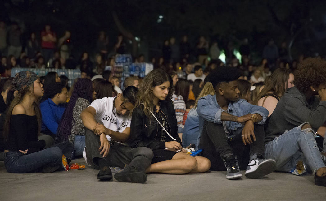 Attendees of a vigil for the shooting victims of the Route 91 country music festival share a moment of silence on Monday, October 2, 2017, at the Student Union courtyard, at UNLV, in Las Vegas. A  ...