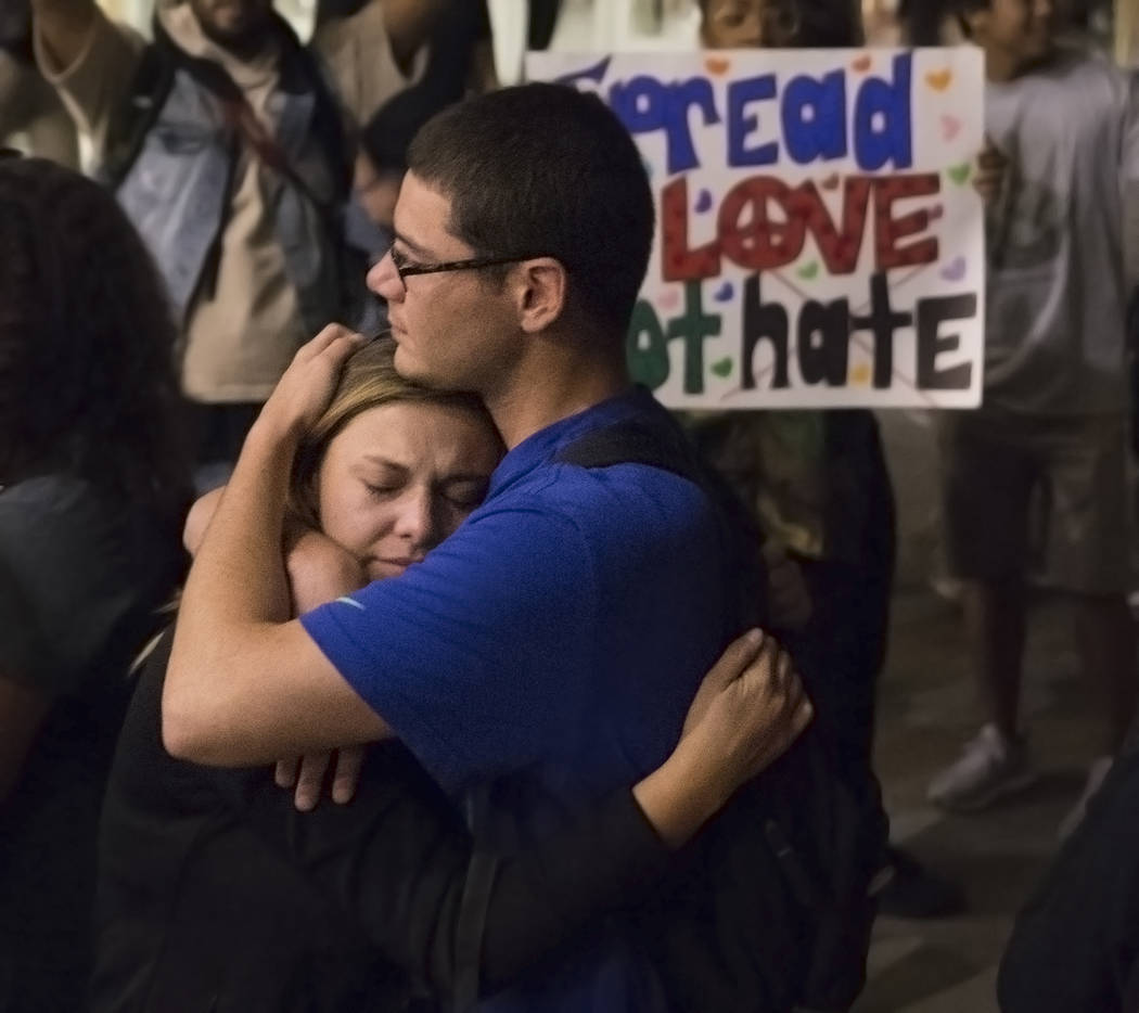 Jessica Brady, left, hugs Daniel Cordova during a vigil for the shooting victims of the Route 91 country music festival on Monday, October 2, 2017, at the Student Union courtyard, at UNLV, in Las  ...