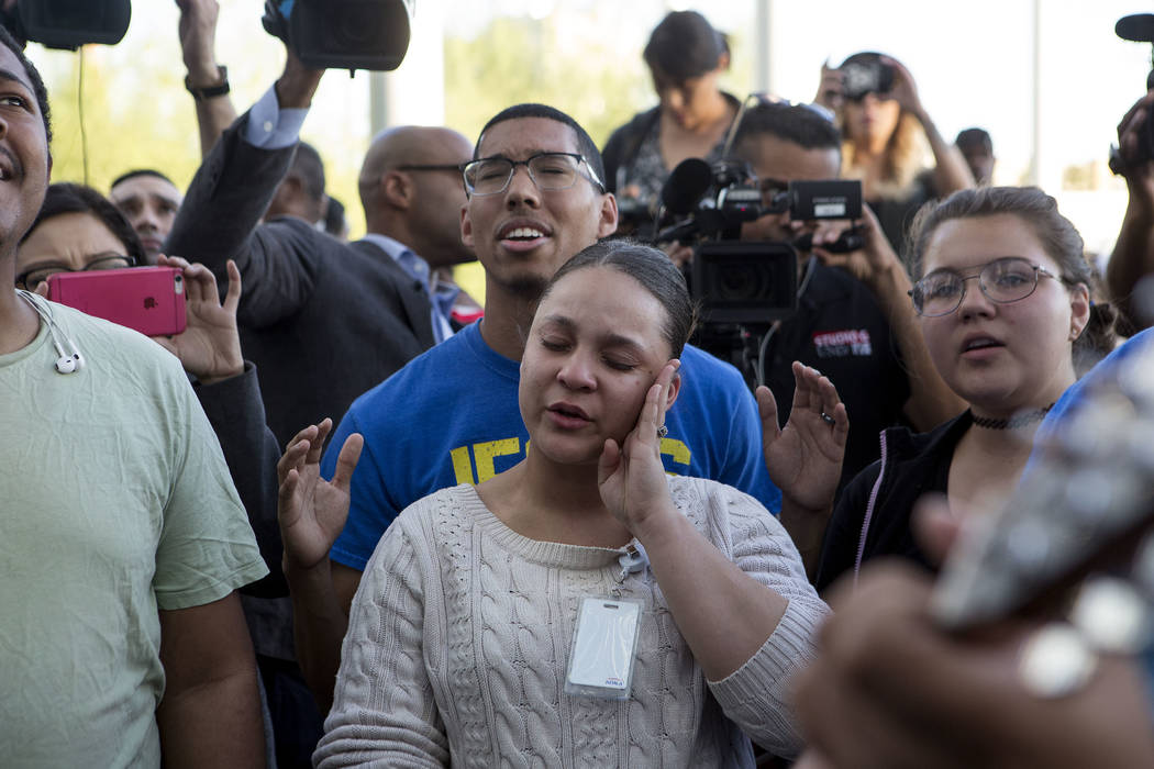 Dawntaya Cooley wipes tears from the side of her face during a vigil at Las Vegas City Hall in Las Vegas, Monday, Oct. 2, 2017. Bridget Bennett Las Vegas Review-Journal @BridgetKBennett
