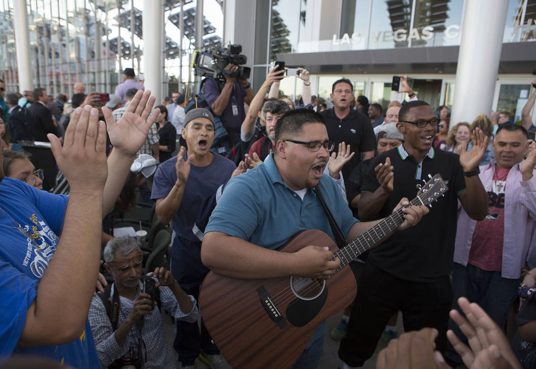 Oscar Ibarra of Victory Outreach Las Vegas leads a group in song during a vigil at Las Vegas City Hall in Las Vegas, Monday, Oct. 2, 2017. Ibarra lead the song with a new guitar he bought that day ...