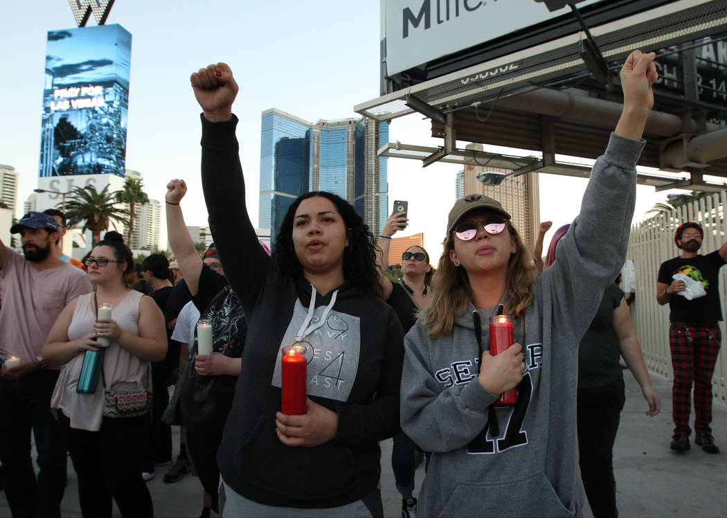 Noelani Epps, left, and Savanah Gales at a candlelight vigil on Monday, Oct. 2, 2017, near East Sahara Avenue and South Las Vegas Boulevard that honored the victims of Sunday's deadly mass shootin ...