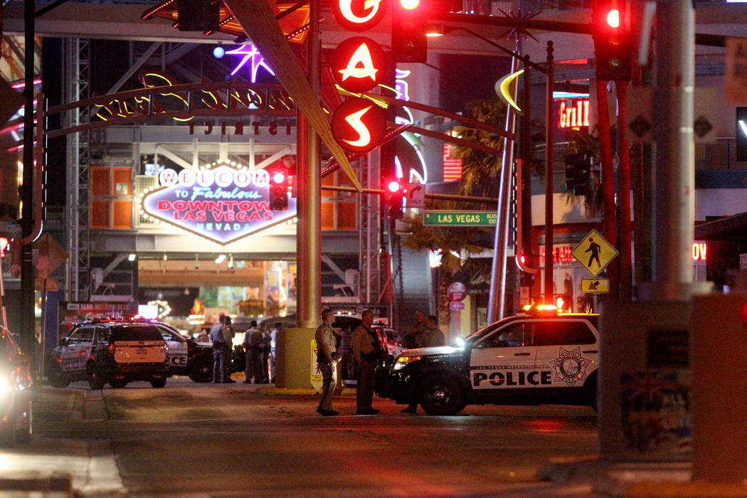 Las Vegas police close access to Fremont Street Experience at Las Vegas Boulevard, North in downtown Las Vegas early Monday, Oct. 2, 2017, after a mass shooting on the Strip that left 50 dead and  ...