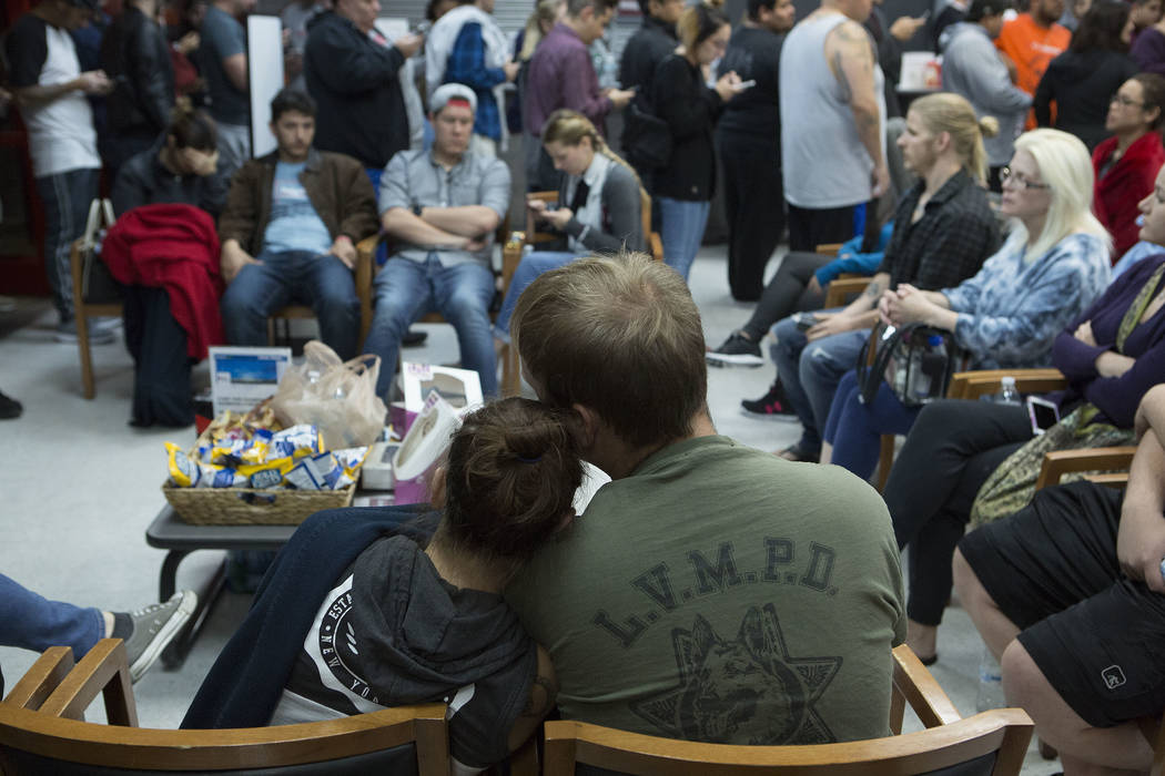 Brittany Hutchinson, left, and Nick Hrustyk wait to donate blood at United Blood Services in Las Vegas Monday, Oct. 2, 2017, following a shooting on the Strip that left 59 dead and over 500 injure ...