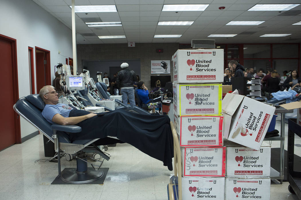 "Dan Stocking donates blood at United Blood Services in Las Vegas Monday, Oct. 2, 2017, following a shooting on the Strip that left 59 dead and over 500 injured Sunday night. ""It's the lea ..."
