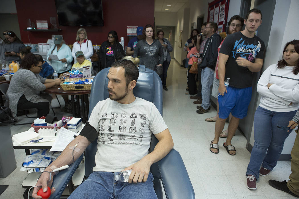 Robin Aiello donates blood at United Blood Services in Las Vegas Monday, Oct. 2, 2017, following a shooting on the Strip that left 59 dead and over 500 injured Sunday night. Bridget Bennett Las Ve ...