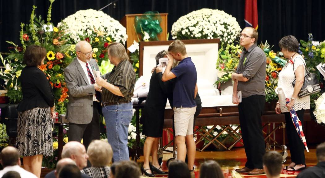 Guests greet family members, from right, Susan Melton, being hugged, father James Melton, grey jacket, stepmother, Janie Brown Melton, left, before the funeral for Sonny Melton Tuesday, Oct. 10, 2 ...