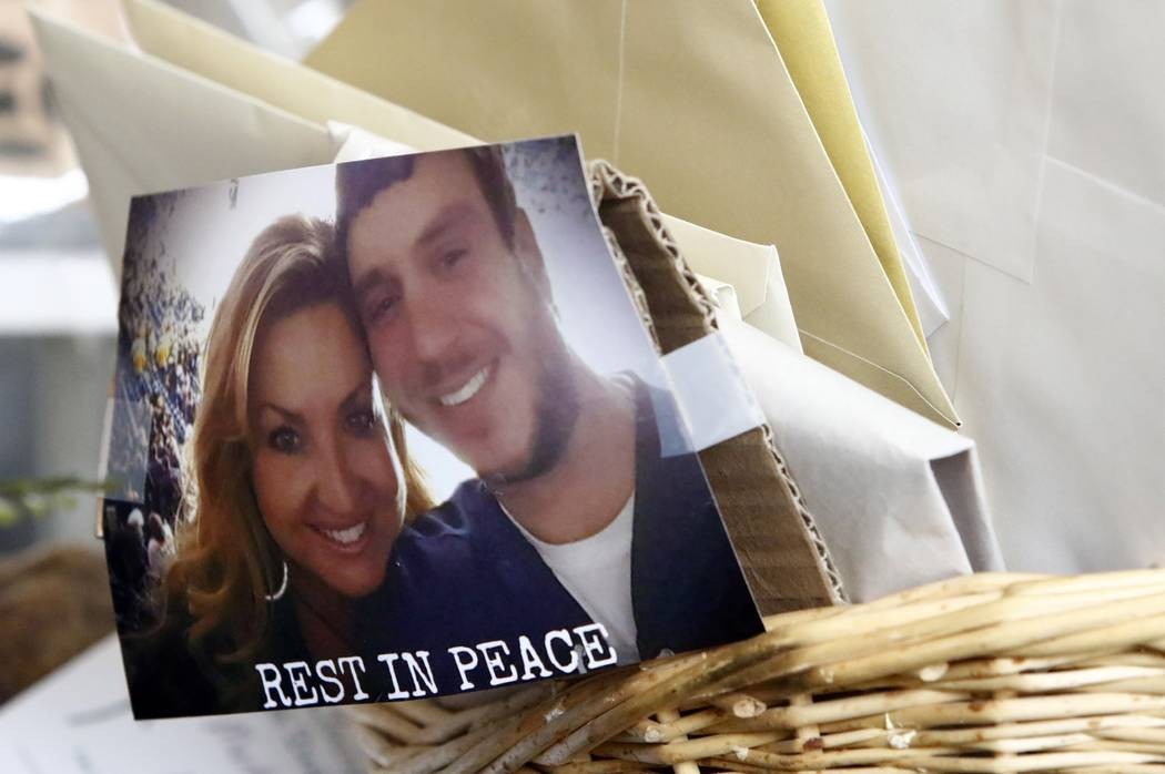 "A photo of James ""Sonny"" Melton and his wife, Heather is seen taped to a basket of cards and letter before the funeral for Sonny Melton on Tuesday, Oct. 10, 2017, in Big Sandy, Tenn. Melton, of Pa ..."
