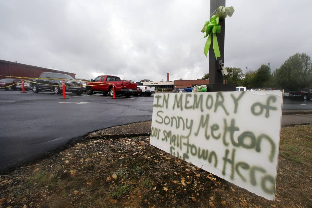 A sign is seen outside the school before the funeral for Sonny Melton Tuesday, Oct. 10, 2017, in Big Sandy, Tenn. Melton, of Paris, Tenn., was one of the victims who died in the Oct. 1 mass shooti ...