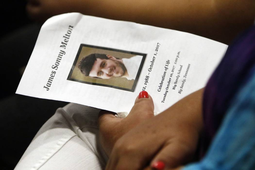 A guest hold a program as she waits for the funeral to start for Sonny Melton Tuesday, Oct. 10, 2017, in Big Sandy, Tenn. Melton, of Paris, Tenn., was one of the victims who died in the Oct. 1 mas ...