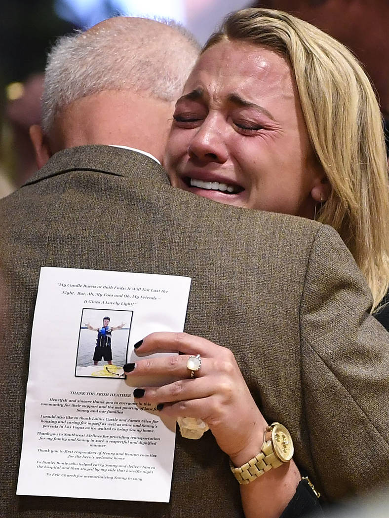 Kelsey Paris becomes emotional as she embraces her grandfather and Sonny Melton's father, James Warren Melton, Monday, Oct. 9, 2017, during Sonny's visitation at Big Sandy High School in Big Sandy ...