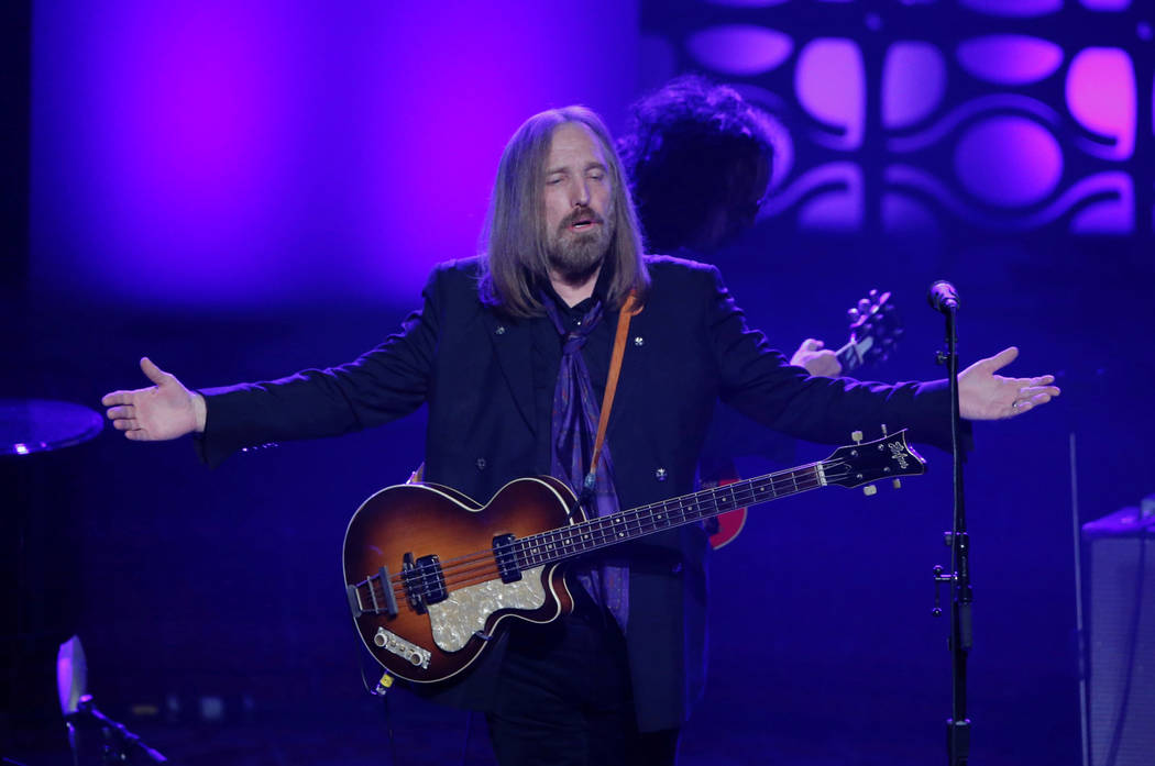 Tom Petty and The Heartbreakers lead singer on stage