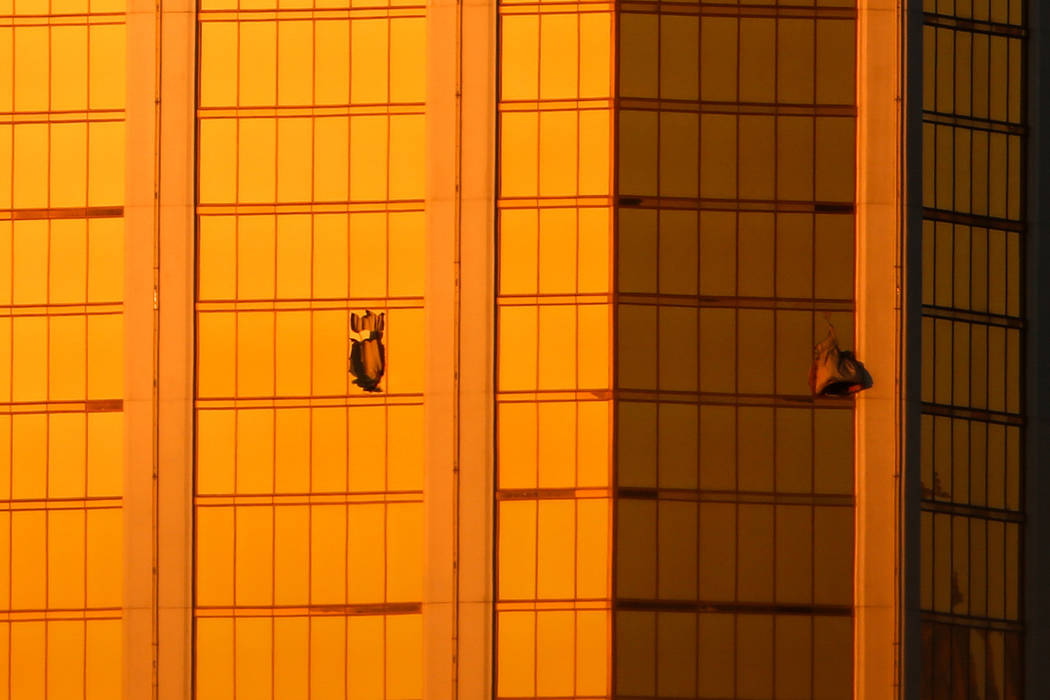 Windows from Mandalay Bay are broken after a shooting occurred leaving at least 50 dead and 200 injured in Las Vegas, Monday, Oct. 2, 2017. Joel Angel Juarez Las Vegas Review-Journal @jajuarezphoto