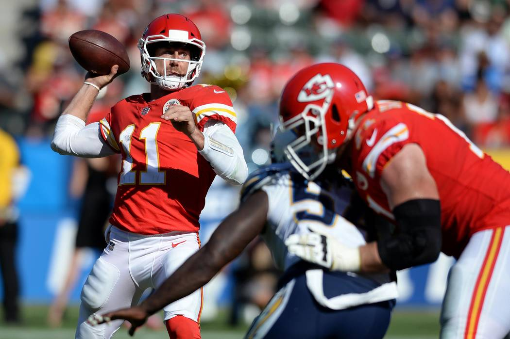 Sep 24, 2017; Carson, CA, USA; Kansas City Chiefs quarterback Alex Smith (11) throws as Los Angeles Chargers outside linebacker Melvin Ingram (54) pressures during the second half at StubHub Cente ...