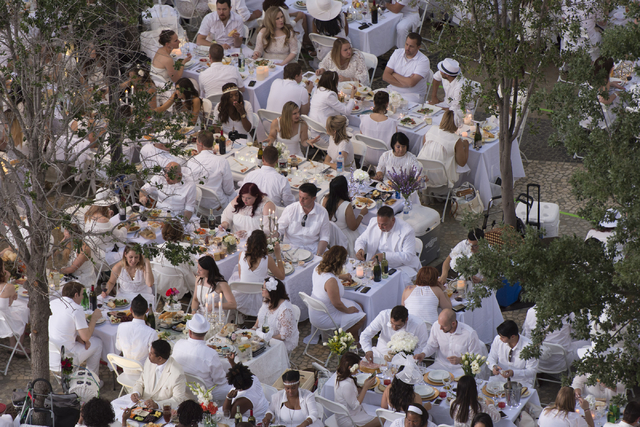 Guests enjoy dinner during the Diner en Blanc pop-up picnic event in this 2016 file photo. Jason Ogulnik/Las Vegas Review-Journal