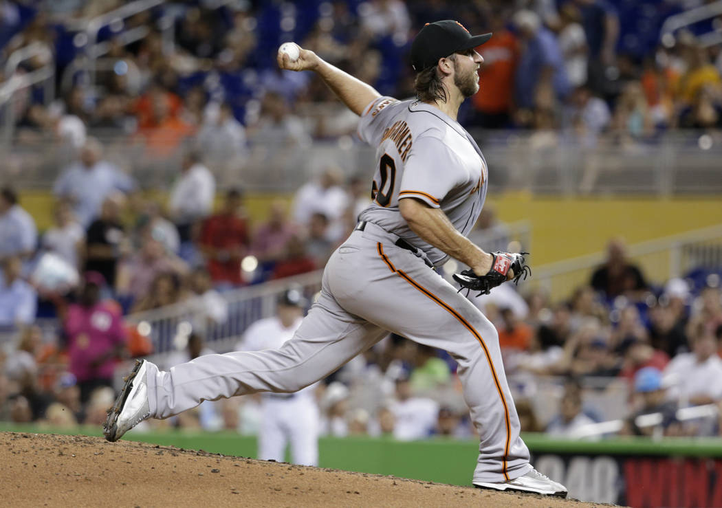 San Francisco Giants starting pitcher Madison Bumgarner delivers during the fourth inning of a baseball game against the Miami Marlins, Tuesday, Aug. 15, 2017, in Miami. (AP Photo/Lynne Sladky)