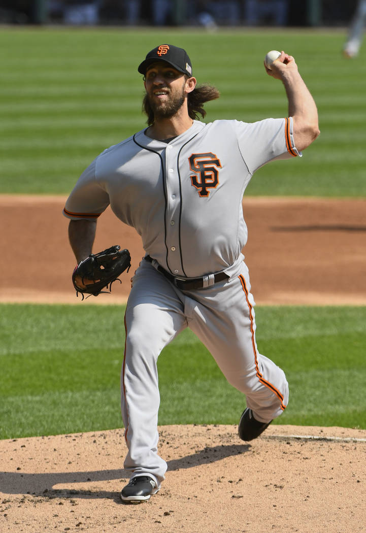 San Francisco Giants starting pitcher Madison Bumgarner (40) delivers against the Chicago White Sox during the first inning of a baseball game in Chicago, Sunday, Sept. 10, 2017. (AP Photo/Matt Ma ...
