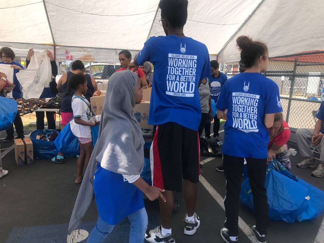 Volunteers pass out items at the Day of Dignity event on Sunday, Oct. 1, 2017 at Masjid As-Sabur, 711 Morgan Ave. (Kailyn Brown/View) @KailynHype