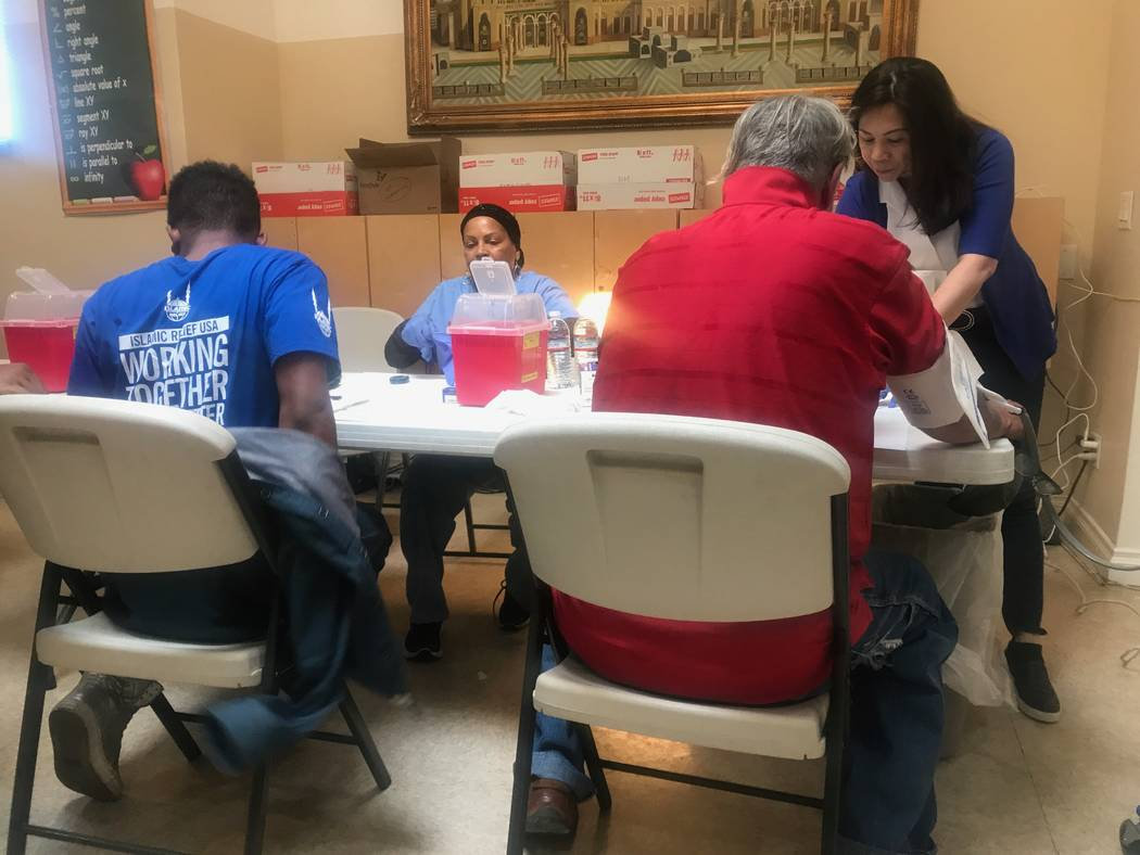 Valley Hospital Medical Center nurses Rah Abdullah and Cynthia Aguilar assist a clients at the free clinic at the Day of Dignity event on Sunday, Oct. 1, 2017 at Masjid As-Sabur, 711 Morgan Ave. ( ...