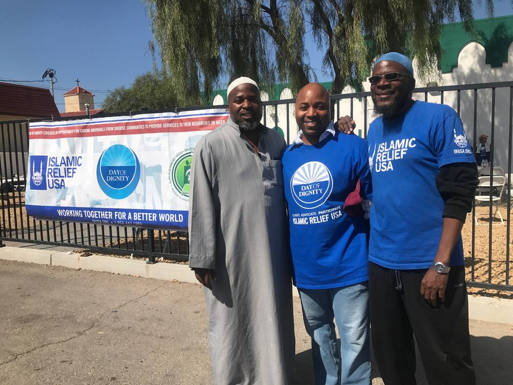 Imam Fateen Seifullah, Joe Mitchell, who is chief of staff to Councilman Ricki Barlow and the mosque's director of outreach Ahmad Ade pose for a portrait on Sunday, Oct. 1 at the Day of Dignity ev ...