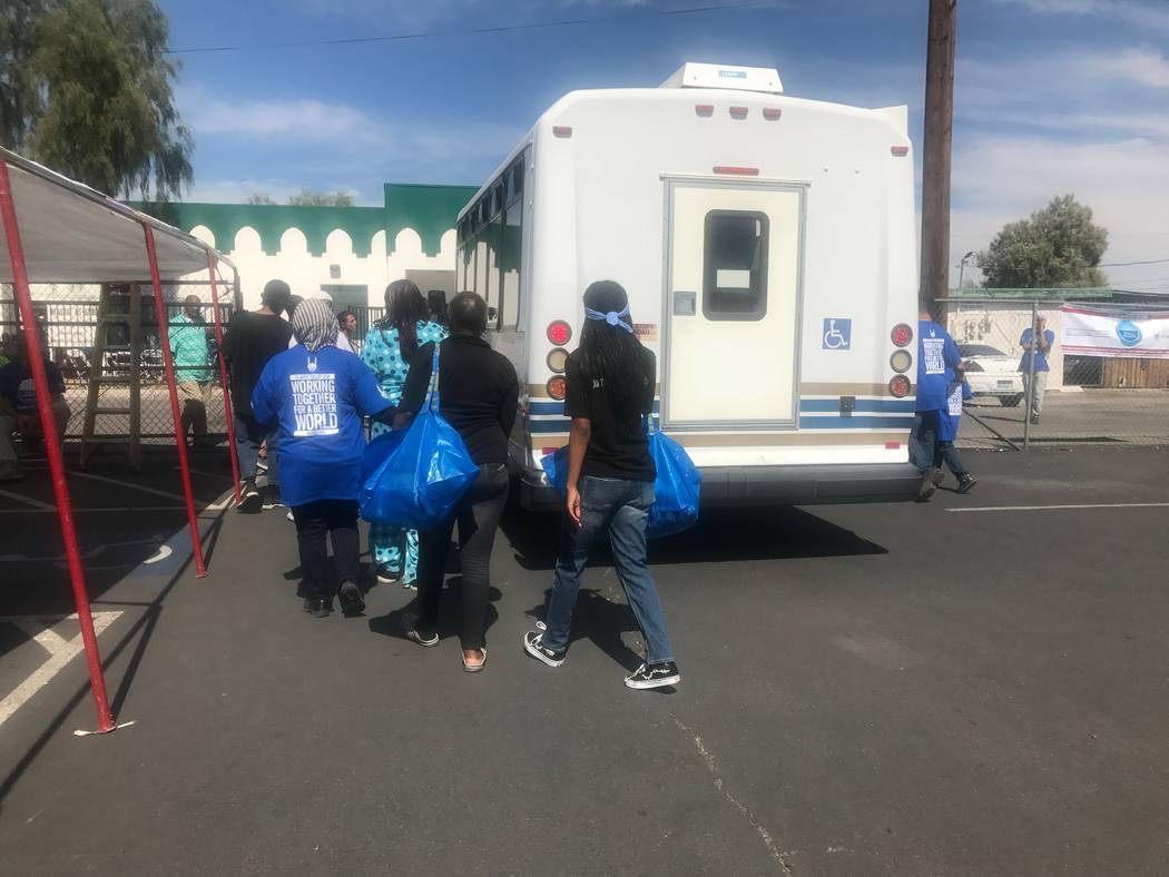 People get off bus that was driven to Masjid As-Sabur to attend the Day of Dignity event on Sunday, Oct. 1, 2017 at Masjid As-Sabur, 711 Morgan Ave. (Kailyn Brown/View) @KailynHype