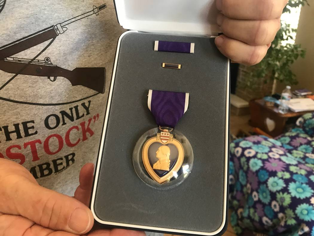 Mike Sanzaro holds up his Purple Heart medal on Oct. 2, 2017 at his North Las Vegas residence. (Kailyn Brown/View) @KailynHype