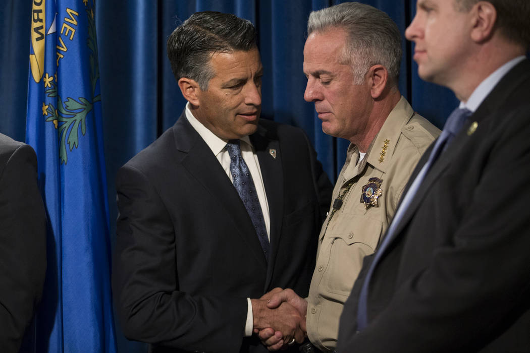 Gov. Brian Sandoval, left, and Clark County County Sheriff Joe Lombardo during a press conference on the mass shooting, at the Las Vegas Metropolitan Police Department headquarters in Las Vegas, M ...