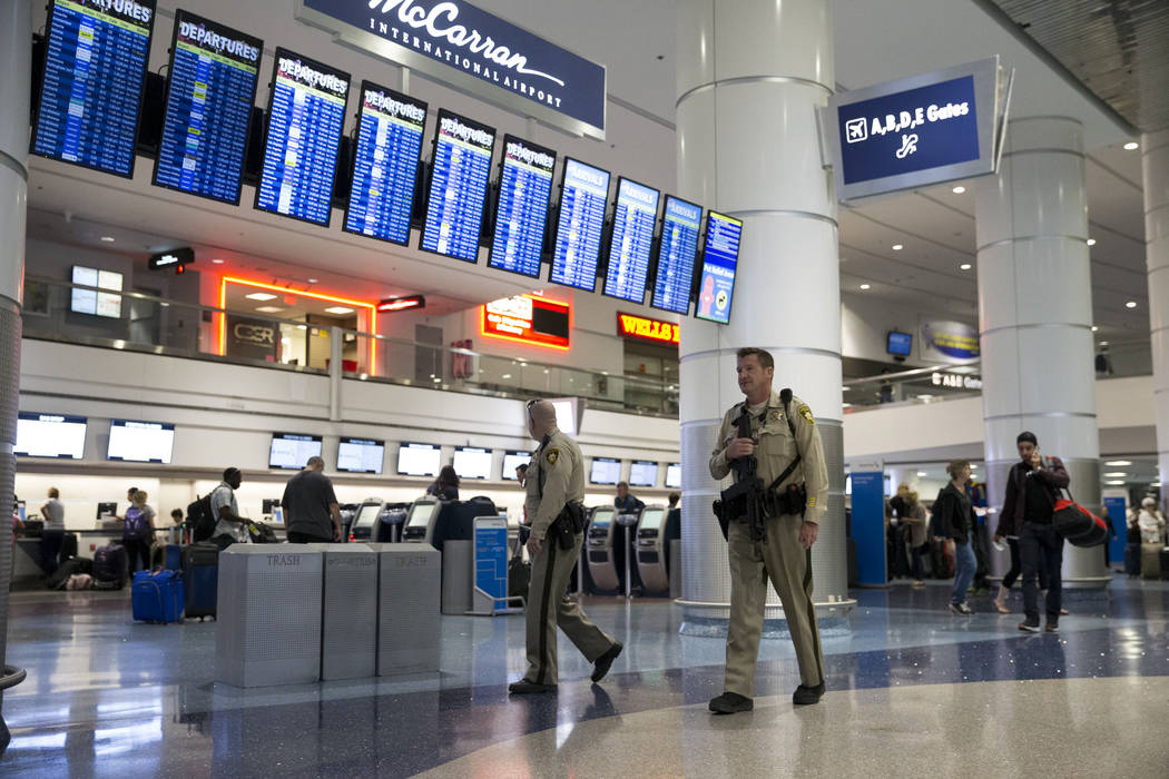 Las Vegas police officers patrol Terminal 1 at McCarran International Airport in Las Vegas, Monday, Oct. 2, 2017. Erik Verduzco/Las Vegas Review-Journal