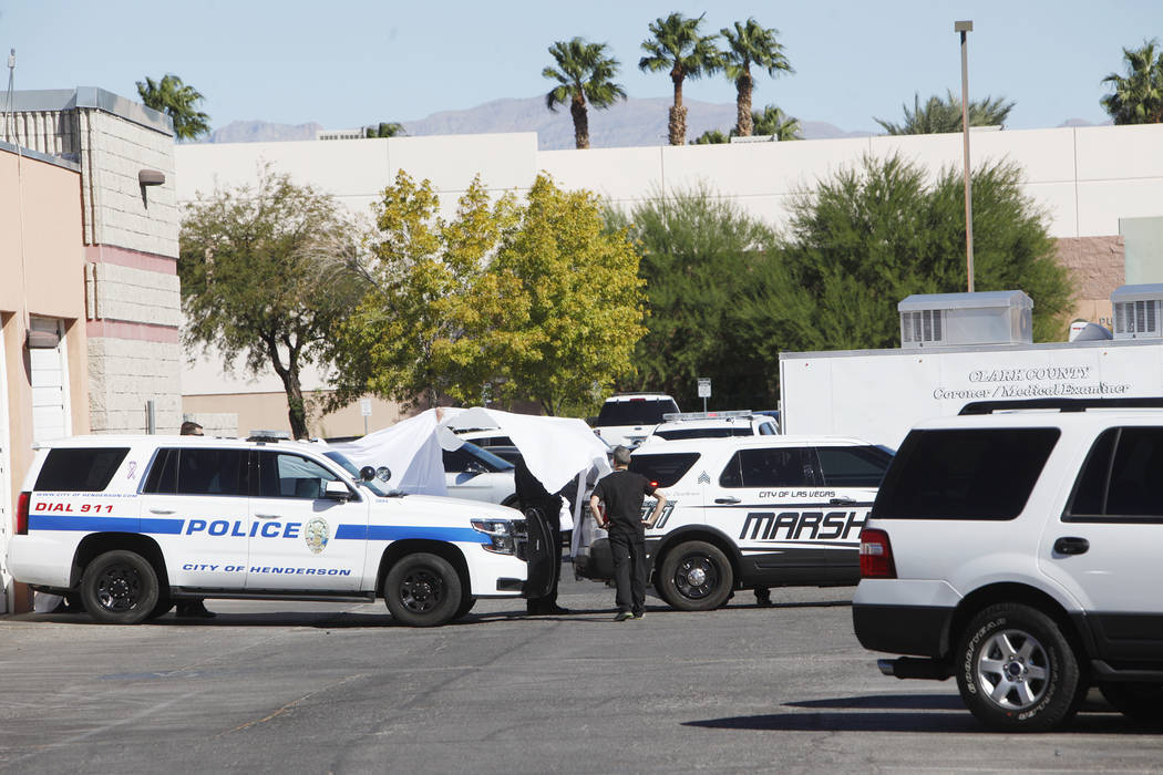 Police hold white sheets up as a coroner and medical examiner trailer backs into the Clark County Coroner's office in Las Vegas, Monday, Oct. 2, 2017. Rachel Aston Las Vegas Review-Journal @rookie ...