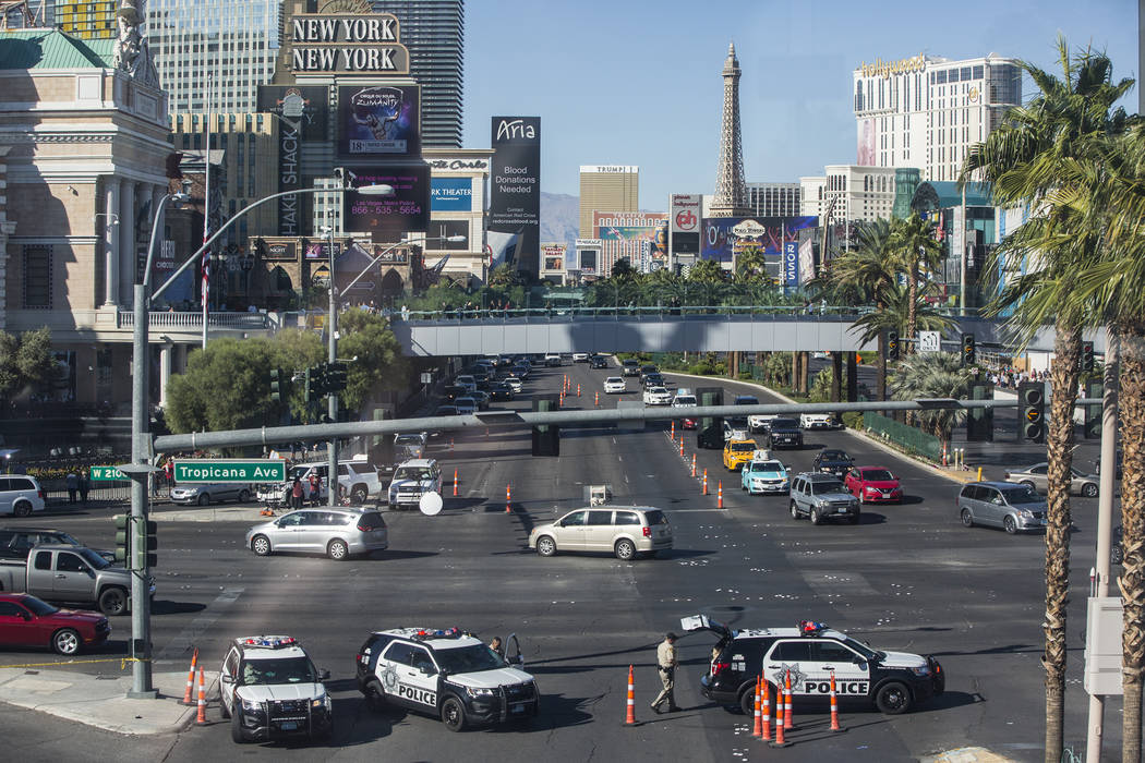 Metro blocks the entrance to Las Vegas Boulevard at Tropicana Avenue on Monday, October 2, 2017, after a gunman in a Mandalay Bay hotel room shot into a crowd of thousands at an outdoor country mu ...