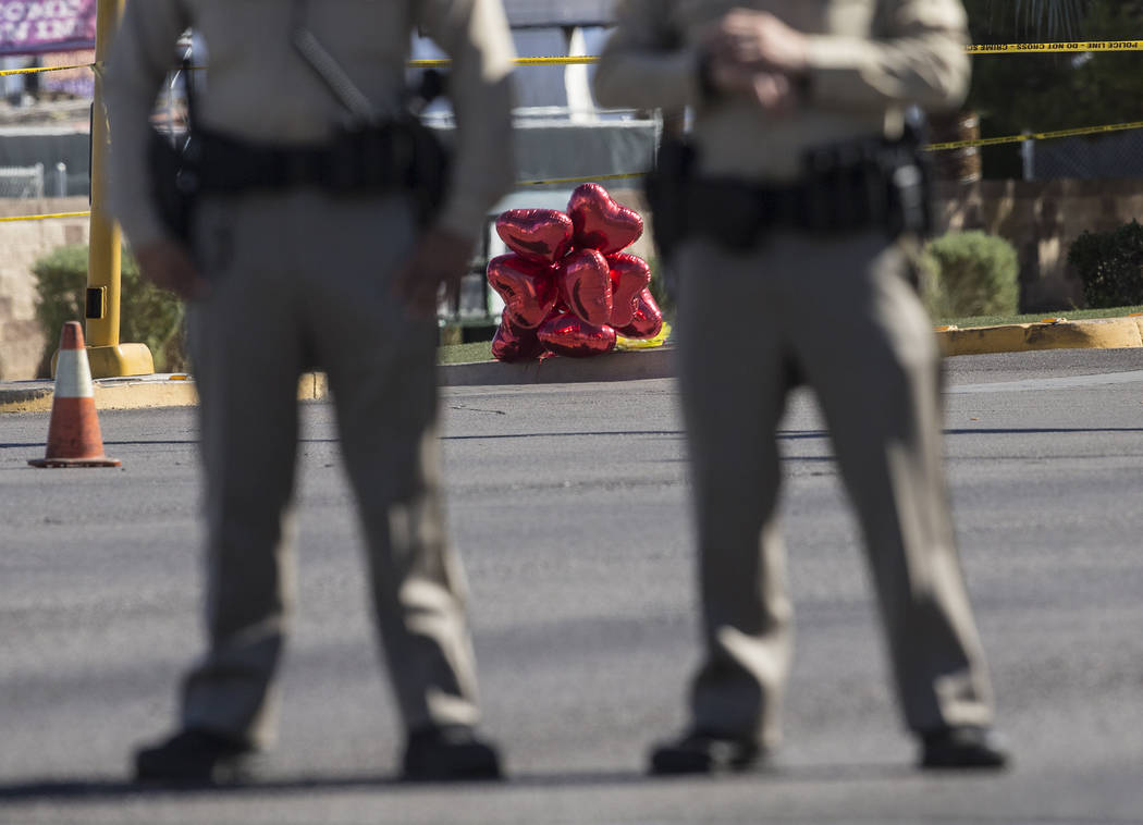A large group of balloons supporting the victims of  Sunday night's mass shooting were placed on Las Vegas Boulevard and West Reno Avenue across from the Mandalay Bay hotel/casino on Monday, Octob ...