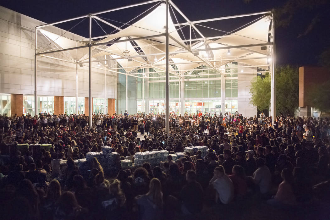 Attendees packed the UNLV Student Union courtyard during a vigil for the shooting victims of the Route 91 country music festival on Monday, October 2, 2017, in Las Vegas. A gunman in a Mandalay Ba ...