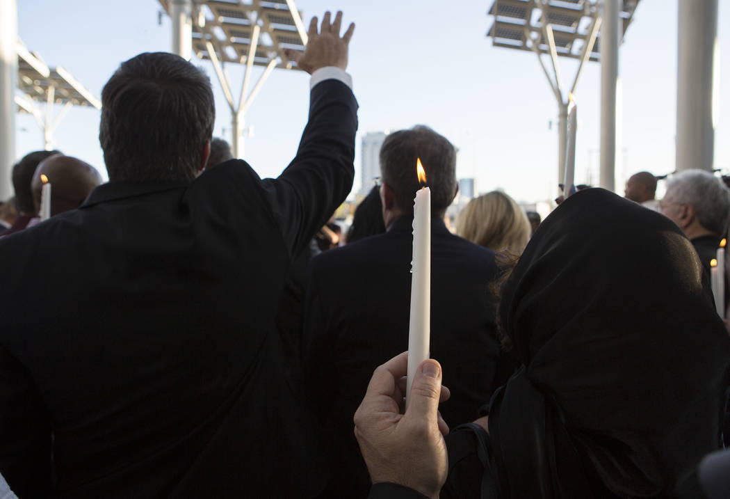 People gather for a vigil for victims of Las Vegas shooting massacre at Las Vegas City Hall in Las Vegas, Monday, Oct. 2, 2017. Bridget Bennett Las Vegas Review-Journal @BridgetKBennett