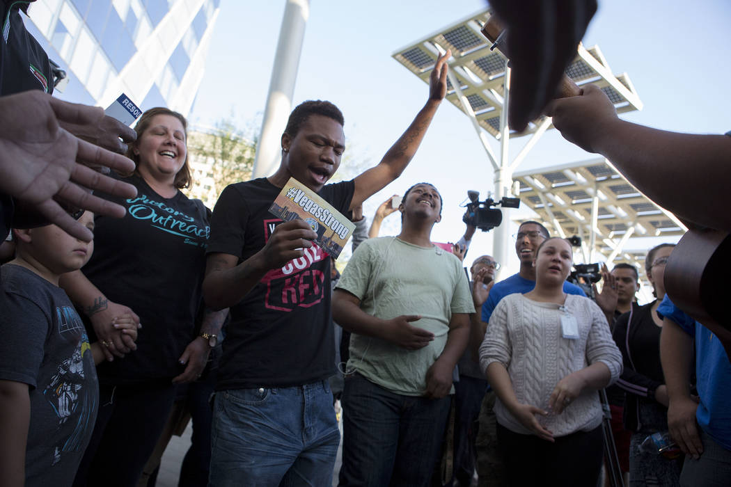 Joseph Howard raises his arms and joins a group in song during a vigil at Las Vegas City Hall in Las Vegas, Monday, Oct. 2, 2017. Bridget Bennett Las Vegas Review-Journal @BridgetKBennett