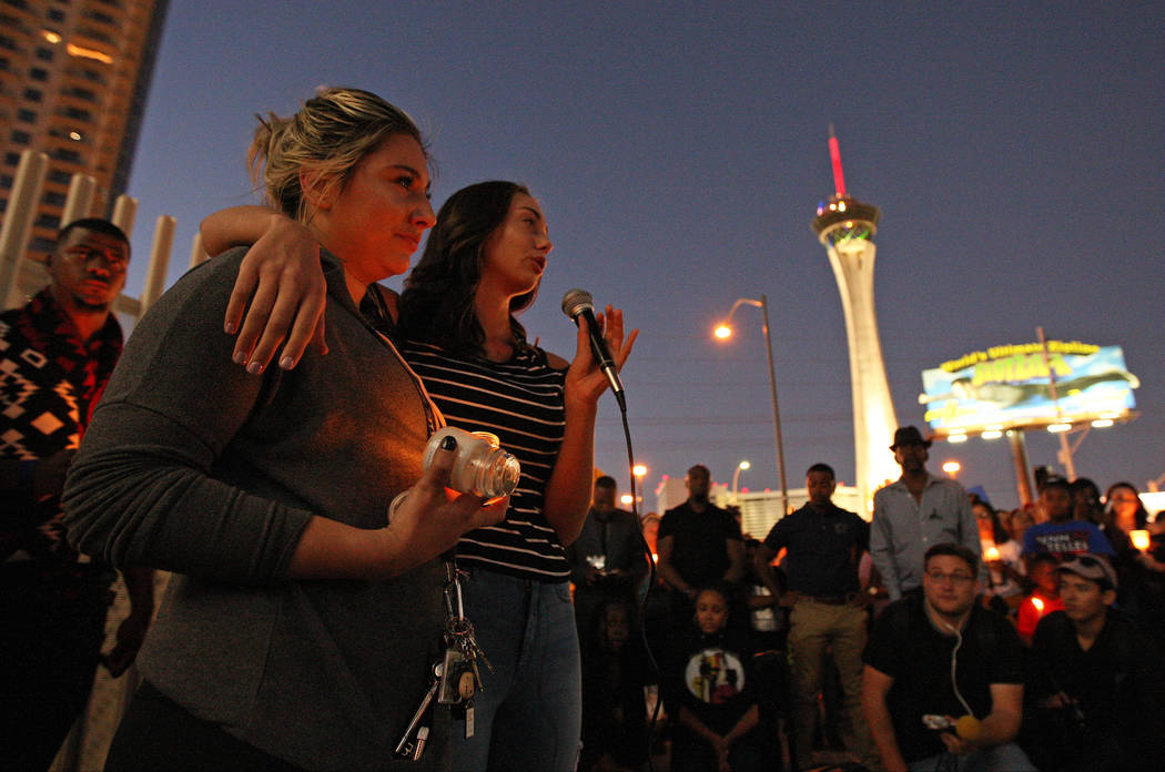 Melissa Morelli, left, and Gigi Bastian tearfully speak during a candlelight vigil ceremony, near East Sahara Avenue and South Las Vegas Boulevard, about the people they lost in the shooting that  ...
