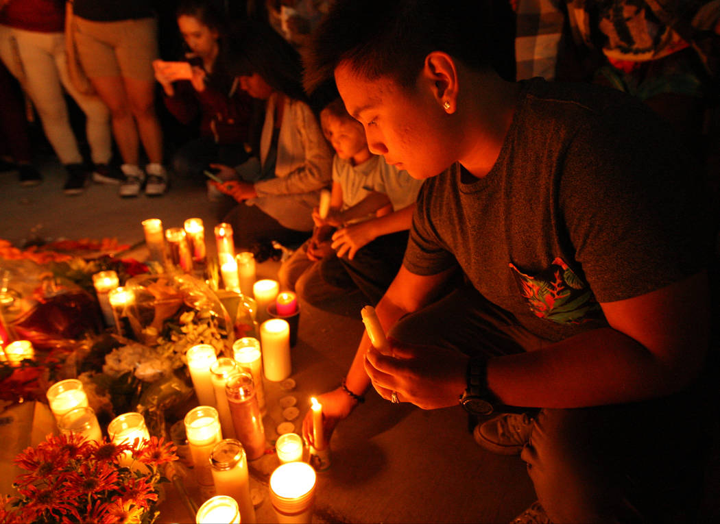 Candles being placed as part of the vigil, near East Sahara Avenue and South Las Vegas Boulevard, that honors the victims of the shooting that occurred Oct. 1 in Las Vegas, Monday, Oct. 2, 2017. G ...