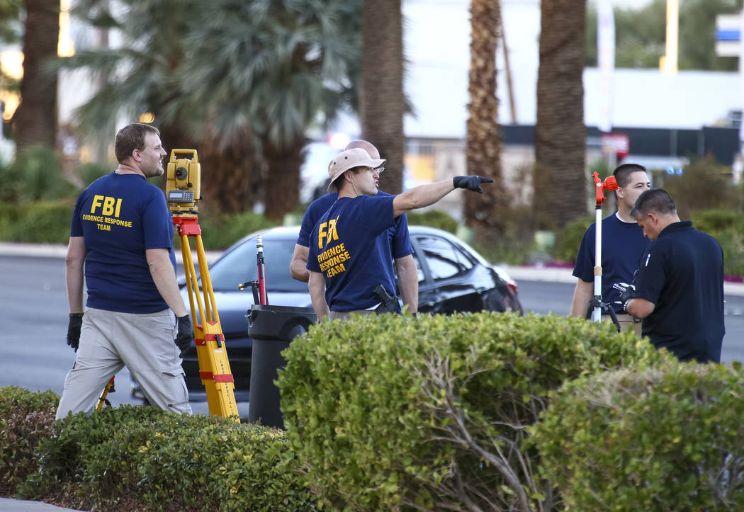 The FBI continues to investigate the scene along Las Vegas Boulevard on Monday, Oct. 2, 2017, following the mass shooting at Route 91 Harvest country music festival in Las Vegas. Richard Brian Las ...
