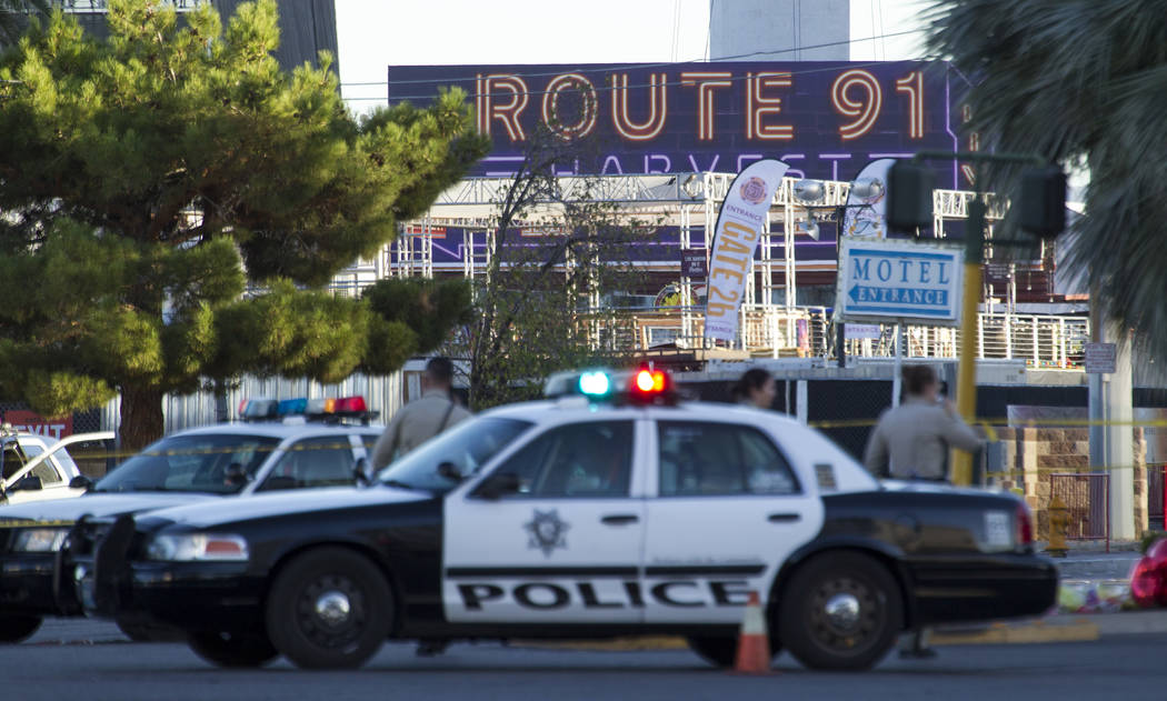 Metro police block the roads at the scene along Las Vegas Boulevard and Reno Avenue on Monday, Oct. 2, 2017, following the mass shooting at Route 91 Harvest country music festival in Las Vegas. Ri ...