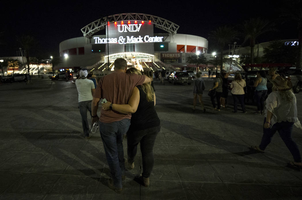 Festival-goers attending the Route 91 Harvest Festival were evacuated by bus to Thomas and Mack Arena early Monday morning, Oct. 2, 2017, following a shooting situation on the Las Vegas Strip. (Ri ...