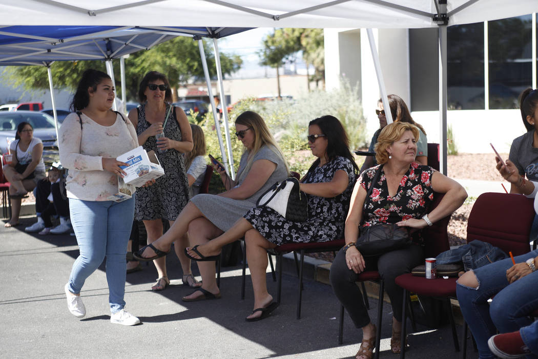 People wait in chairs to donate blood at the University Medical Center parking lot in Las Vegas, Monday, Oct. 2, 2017. UMC set up a blood donation area to assist with victims injured in the shooti ...